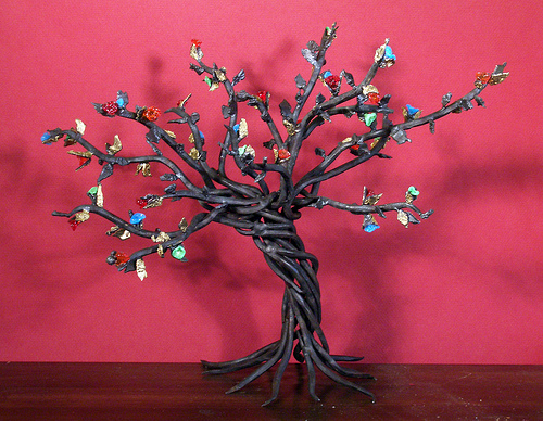 Tree sculpture commission: steel tree with glass flowers and painted leaves.