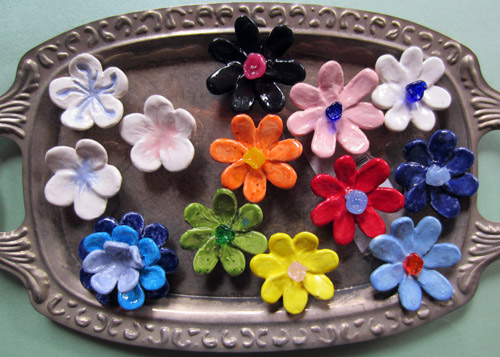 Cermamic flower magnets (some with glass flower accents).